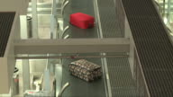 Conveyor belt at checkin counter at airport with two baggage items Cape Town International Airport is located in Cape Town South Africa and is the...
