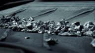 Conveyor belt transporting scrap metal