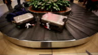 Conveyor belt turning at airport baggage claim.Real time.