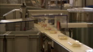 A conveyor moves packaged cheese through a food-processing plant in Bern, Switzerland.