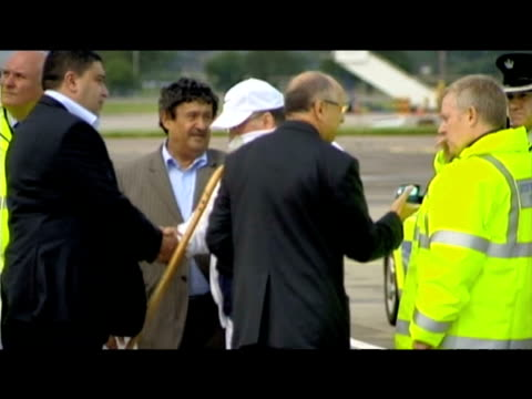 Convicted Lockerbie Bomber Abdelbaset Ali alMegrahi exits white van and boards aircraft following his release from Greenock Prison Glasgow Airport...