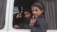 A convoy including buses and ambulances evacuating civilians trying to flee from East Aleppo that had been under siege by Assad regime forces and...