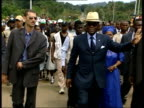 EXT Convoy of cars along Colonel Teodoro Obiang Nguema Mbasogo along with bodyguards Women dancing at welcoming ceremony Teodoro Obiang Nguema...