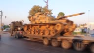 A convoy of military vehicles including tanks makes its way through the border TurkishSyrian border as part of Turkey's military reinforcements along...