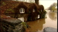 Conwy Llanrwst Flooded car park and road Thatched cottage surrounded by floodwater Flowing floodwater Four wheel drive car towards through floodwater...