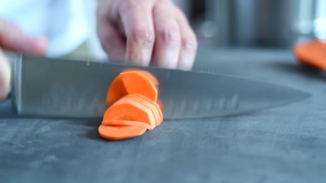 cook hands cut carrot