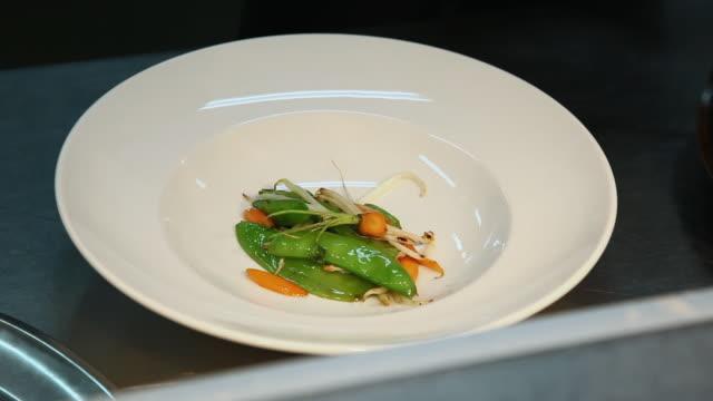 CU TU Cook serving vegetable dish / Port de Soller, Mallorca, Baleares, Spain