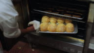 MS PAN cook turning bread in the oven / Truxton's, CA, United States
