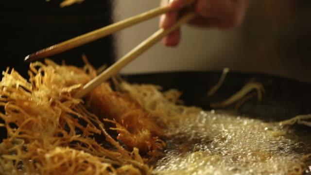 MS Cook/Chef preparing a prawn tempura dish, typical Japanese food deep frying / Sao Paulo, Brazil
