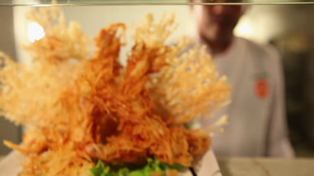 MS Cook/Chef preparing a prawn tempura dish typical Japanese food final dish travelling / Sao Paulo, Brazil