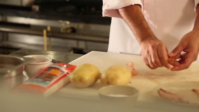 MS PAN Cook/Chef preparing a prawn tempura dish, typical Japanese food / Sao Paulo, Brazil