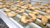 Cooked Chicken Wings on Processing Machine