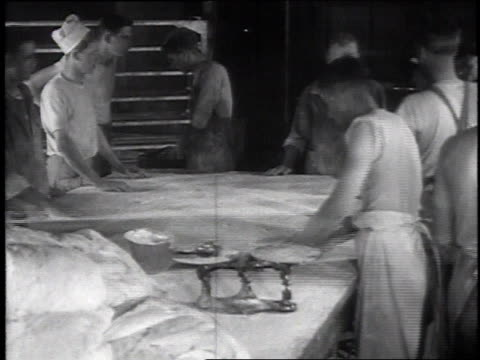 Cookhouse chefs kneading bread dough on floured table sergeant looking over their shoulders / Camp Sherman Chillicothe Ohio United States