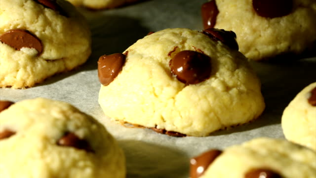 Cookies baking in the oven with chocolate drops.