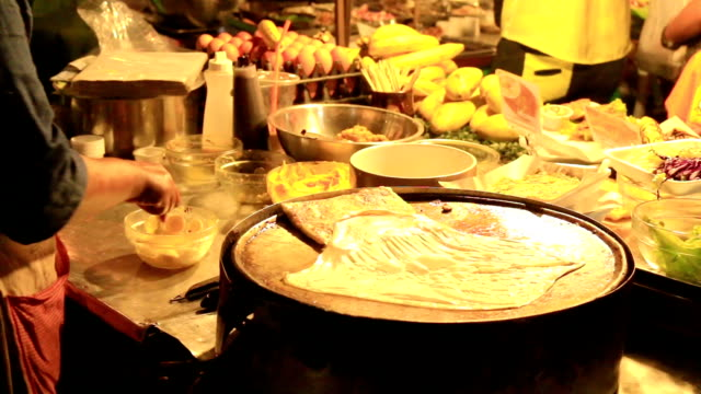 HD: Cooking at a street hawker mobile restaurant in Thailand