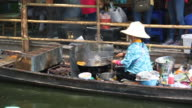 Cooking local food at floating market
