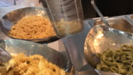 Cooking pasta by professional chef , Bangkok , Thailand