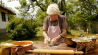 Cooking With Grandma-Old Farmer Lady Making a Loaf of Bread