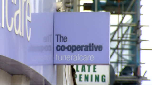 Cooperative Group delegates vote in favour of reforms at special meeting in Manchester LIB EXT 'The cooperative funeralcare' shop sign 'The...