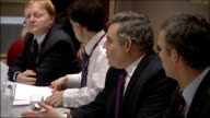 Gordon Brown in meeting and with Al Gore DENMARK Copenhagen INT Gordon Brown along corridor into room / Brown sat at table for meeting apologises for...