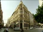 Corner of ornate building as traffic passes below