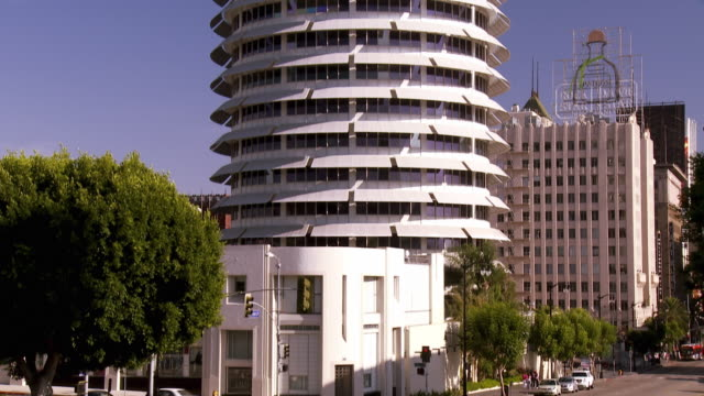 WS TU Corner of Vine and Yucca street to Capitol Records tower completed in 1956 as the worlds first circular office building designed to resemble a stack of records topped by a stylus / Hollywood, California, USA