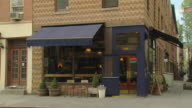 TS corner restaurant with blue awnings / New York, New York, USA