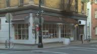TS corner restaurant with brown awnings / New York, New York, USA