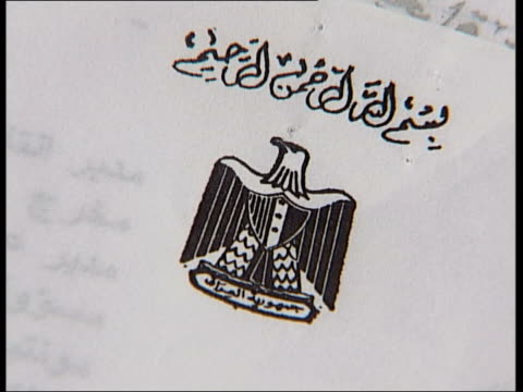 Corners of documents CMS File flicked thru CS Detail of Arab script on document TCMS File open CS Iraqi crest on document CS Detail of Arab script CS...