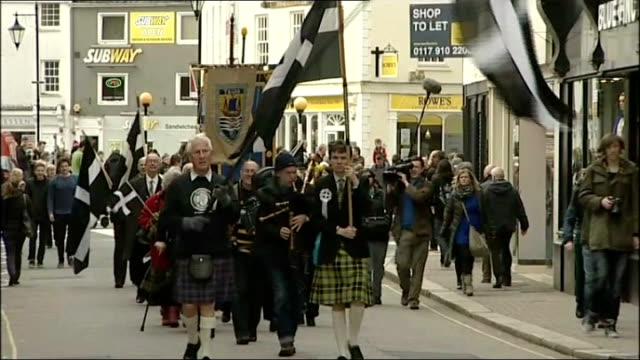 Cornwall granted minority status DATE EXT People towards waving large Cornish flags and wearing Cornish kilts and playing bagpipes Young men with...