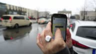 Corp smartphone displays the Uber Technologies Inc car service application as taxis and the Brandenburg Gate stand beyond in Berlin Germany on Monday...