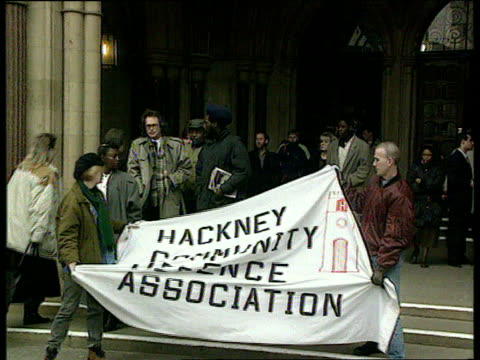 Corruption allegations against officers at Stoke Newington Police Station TX London EXT MS Banner 'Hackney Community Defence Association' held up as...