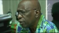 FIFA corruption scandal Jack Warner confronted by Channel 4 News Sign 'We do not give money at this office' on counter Reporter entering constutency...