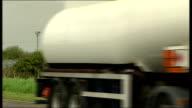 Essex Thurrock Coryton oil refinery EXT BP oil tanker lorry leaving Coryton / Shell oil tanker lorry arriving at oil refinery / Jet petrol tanker...
