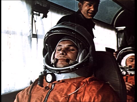 Cosmonaut Yuri Gagarin first man in space Gagarin puts on his space suit is driven by bus to the Vostok 1 rocket w/ his substitute Gherman Titov...