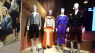 Costumes on display at the Abba Museum in Stockholm Sweden on October 7 Wide shots close ups and pans of Abba costumes on display Close up of sequin...