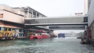 A Cotai Water Jet arrives at the Macau Ferry Pier in Hong Kong China on Wednesday Nov 19 A high speed catamaran arrives at the Macau Ferry pier A man...