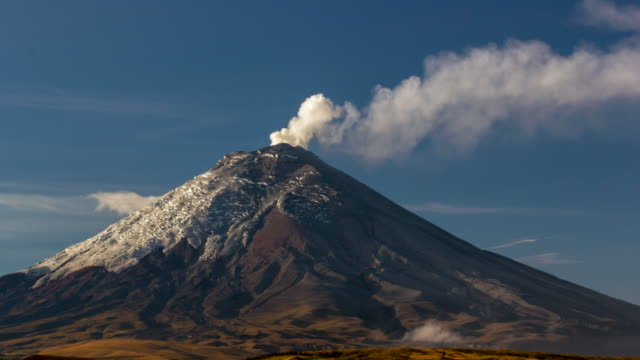 Cotopaxi Volcano, Ecuador erupting in the early morning  on the  21st of October 2015. A band of fumaroles is steaming below the crater
