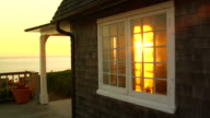 MS, Cottage window from porch at sunset, North Truro, Massachusetts, USA