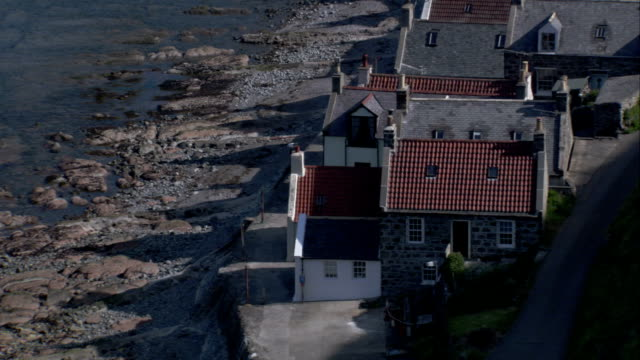 Cottages line the shore in Crovie village, Scotland. Available in HD.