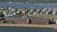 AERIAL Cotton mill on the shoreline, town beyond / New Bedford, Massachusetts, United States