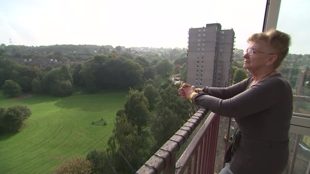 Councils denied cash for sprinklers in tower blocks Nottinghamshire Nottingham EXT Various shots of Jenny Denham standing on balcony of flat in tower...