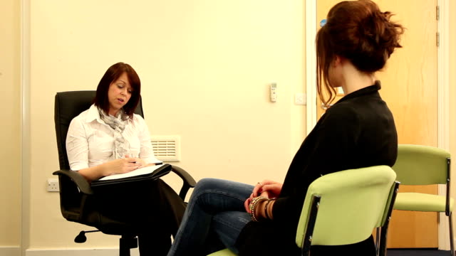 Counsellor / Psychiatrist & Patient talking through issues (Therapy)