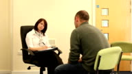 Counsellor / Psychiatrist Therapy session with man