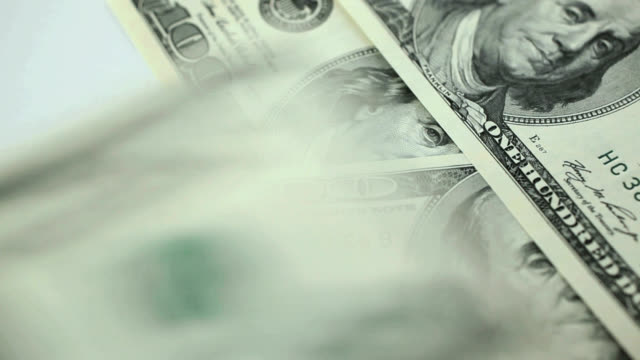 Counting hundred dollar bill.