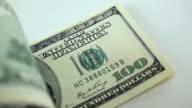 Counting hundred dollar bills