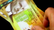 Counting money - Canadian Dollar