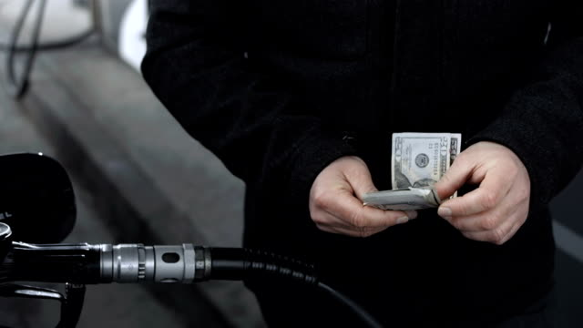 HD: Counting Money On A Gas Station