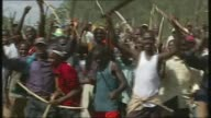 Country votes in general election LIB / Sotik EXT Crowd of Kenyan men brandishing weapons and shouting war cries