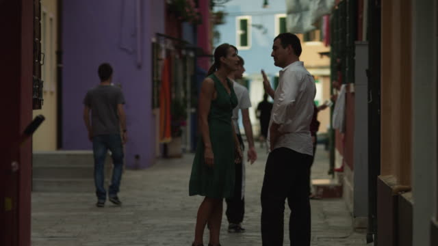 WS Couple arguing on street / Murano